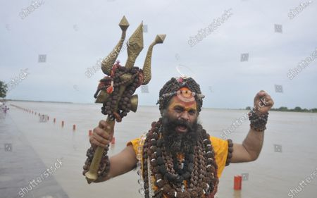 Mauni Baba, a hindu sadhu, performs rituals at banks of the river Saryu on the day of the foundation laying of the Ram Temple on August 5, 2020 in Ayodhya, India. Prime Minister Narendra Modi said on Wednesday the construction of Ram temple will not only add to Ayodhya's grandeur but will also change the entire economy of the region after laying the foundation stone in accordance with the 'muhurat' or auspicious time.
