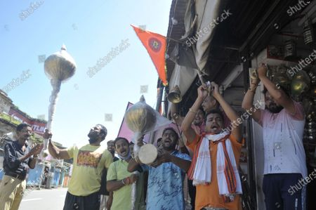 People cheer at a store selling temple paraphernalia during festivities on the day of Bhumi Poojan of Ram Temple  on August 5, 2020 in Ayodhya, India. Prime Minister Narendra Modi said on Wednesday the construction of Ram temple will not only add to Ayodhya's grandeur but will also change the entire economy of the region after laying the foundation stone in accordance with the 'muhurat' or auspicious time.