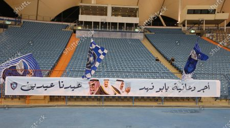A banner depicting Saudi King Salman bin Abdulaziz Al Saud and felicitation messages after he underwent medical tests recently, is placed at the empty stadium before the start of the Saudi Professional League soccer match between Al-Nassr and Al-Hilal, Riyadh, Saudi Arabia, 05 August 2020.