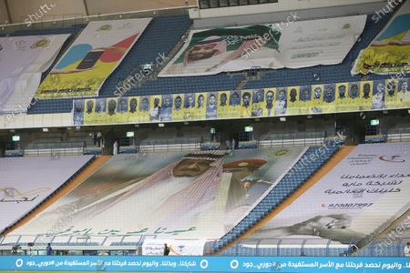 A poster depicting Saudi King Salman bin Abdulaziz Al Saud (bottom) and felicitation messages after he underwent medical tests recently, is placed at the empty stadium before the start of the Saudi Professional League soccer match between Al-Nassr and Al-Hilal, Riyadh, Saudi Arabia, 05 August 2020.