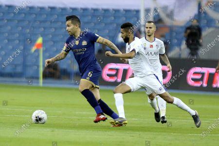 Al-Nassr's Brazilian player Petros (L) in action against Al-Hilal's Salman Al-Faraj (R) during the Saudi Professional League soccer match between Al-Nassr and Al-Hilal, Riyadh, Saudi Arabia, 05 August 2020.