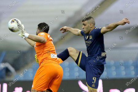 Al-Nassr's Moroccan player Abderazak Hamdallah (R) vies for the ball against Al-Hilal's goalkeeper Abdullah Al-Mayouf during the Saudi Professional League soccer match between Al-Nassr and Al-Hilal, Riyadh, Saudi Arabia, 05 August 2020.