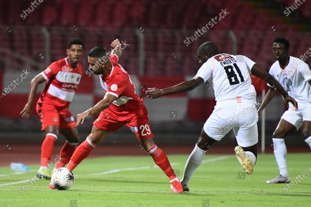 Al-Shabab player Alfred N'Diaye (C-L) in action with Al-Wahda player Rakan Al-Shamlan (C-R) during the Saudi Professional League soccer match between Al-Wahda and Al-Shabab, Mecca, Saudi Arabia, 05 August 2020.
