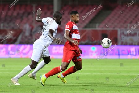 Al-Shabab player Alfred N'Diaye (L) in action with Al-Wahda player Anselmo De Moraes (R) during the Saudi Professional League soccer match between Al-Wahda and Al-Shabab, Mecca, Saudi Arabia, 05 August 2020.