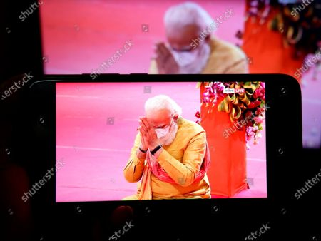 In this photo illustration, Indian Prime Minister, Narendra Modi seen performing rituals while inaugurating the stone laying ceremony for the Hindu Ram Temple at Ayodhya, Uttar Pradesh on a Smartphone.