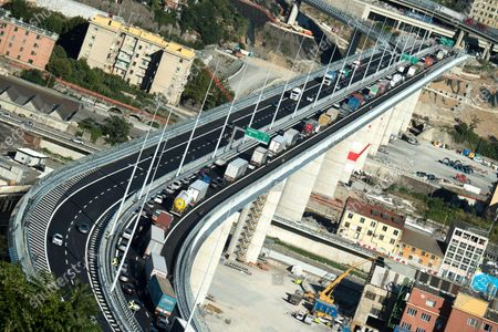 Vehicles proceed in line drive across the new Genoa-Saint George viaduct, following its reopening for traffic, in Genoa, Italy, 05 August 2020. The new viaduct was inaugurated on 03 August, two years after the Morandi bridge collapsed claiming 43 lives. The new viaduct was designed by award-winning architect Renzo Piano.