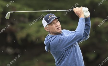Stock Image of Davis Love III of the US hits his tee shot on the eleventh hole during the final practice round for the 2020 PGA Championship golf tournament at TPC Harding Park in San Francisco, California, USA, 05 August 2020. The competition will be played 06 August through 09 August with no fans in attendance.