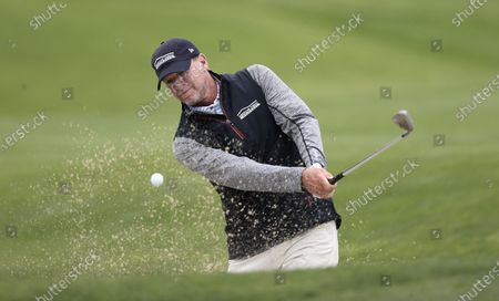 Stock Image of Steve Stricker of the US hits out of a bunker on the tenth hole during the final practice round for the 2020 PGA Championship golf tournament at TPC Harding Park in San Francisco, California, USA, 05 August 2020. The competition will be played 06 August through 09 August with no fans in attendance.