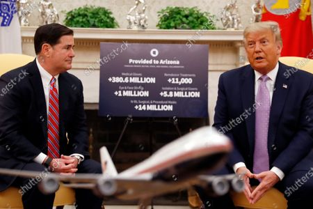 President Donald Trump meets with Arizona Gov. Doug Ducey in the Oval Office of the White House in Washington