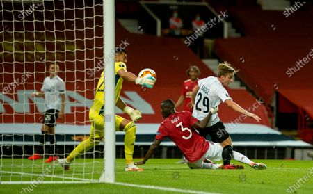 Manchester United's goalkeeper Sergio Romero saves a shot from Linz' Marko Raguz (R) during the UEFA Europa League round of 16 second leg soccer match between Manchester United and Linz held at Old Trafford in Manchester, Britain, 05 August 2020.