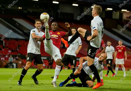 Linz' James Holland (L) and Philipp Wiesinger (L) in action with Manchester United's Odion Ighalo (C) during the UEFA Europa League round of 16 second leg soccer match between Manchester United and Linz held at Old Trafford in Manchester, Britain, 05 August 2020.