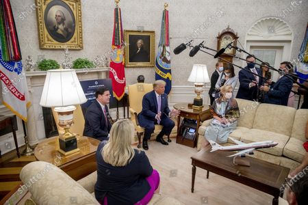 President Donald Trump, accompanied by Arizona Gov. Doug Ducey, left, his Deputy Chief of Staff Gretchen Conger, second from left, and Dr. Deborah Birx, White House coronavirus response coordinator, right, speaks in the Oval Office of the White House in Washington