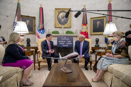 President Donald Trump meets with Arizona Gov. Doug Ducey in the Oval Office of the White House in Washington, . Also pictured is Ducey's Deputy Chief of Staff Gretchen Conger, left, and Dr. Deborah Birx, White House coronavirus response coordinator, right