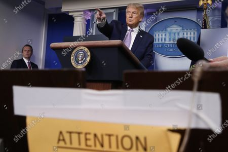 President Donald Trump speaks during a briefing with reporters in the James Brady Press Briefing Room of the White House, in Washington