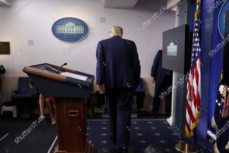 President Donald Trump leaves after speaking during a briefing with reporters in the James Brady Press Briefing Room of the White House, in Washington