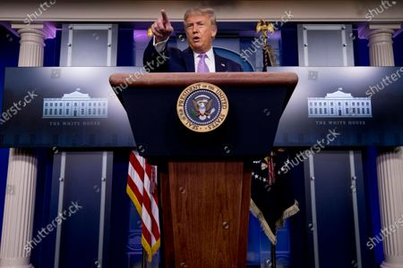 President Donald Trump calls on a reporter during a briefing in the James Brady Press Briefing Room of the White House, in Washington