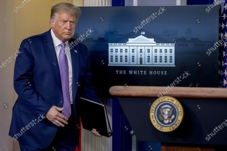 President Donald Trump arrives for a briefing in the James Brady Press Briefing Room of the White House, in Washington