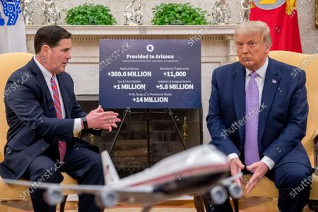 Arizona Gov. Doug Ducey, accompanied by President Donald Trump, speaks in the Oval Office of the White House in Washington
