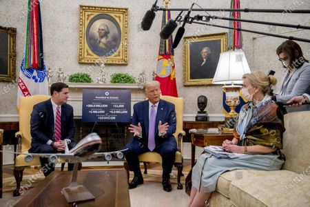 President Donald Trump, center, accompanied by Arizona Gov. Doug Ducey, left, and Dr. Deborah Birx, White House coronavirus response coordinator, right, speaks in the Oval Office of the White House in Washington