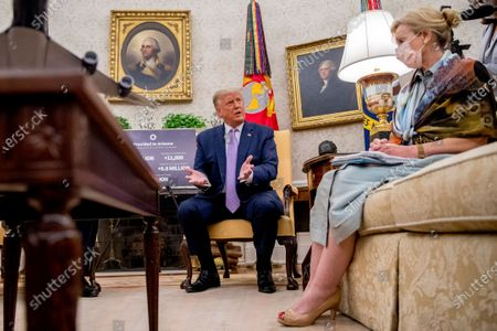 President Donald Trump, accompanied by Dr. Deborah Birx, White House coronavirus response coordinator, right, speaks during a meeting with Arizona Gov. Doug Ducey in the Oval Office of the White House in Washington