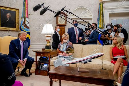 President Donald Trump, left, accompanied by Dr. Deborah Birx, White House coronavirus response coordinator, center, and White House Press Secretary Kayleigh McEnany, right, speaks during a meeting with Arizona Gov. Doug Ducey in the Oval Office of the White House in Washington