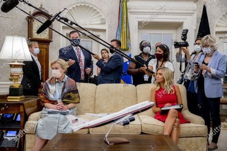Dr. Deborah Birx, White House coronavirus response coordinator, left, and White House Press Secretary Kayleigh McEnany, right, appear for a meeting between President Donald Trump and Arizona Gov. Doug Ducey in the Oval Office of the White House in Washington
