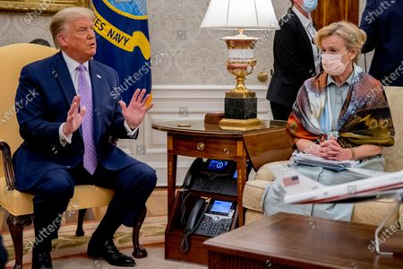 President Donald Trump, left, accompanied by Dr. Deborah Birx, White House coronavirus response coordinator, right, speaks during a meeting with Arizona Gov. Doug Ducey in the Oval Office of the White House in Washington
