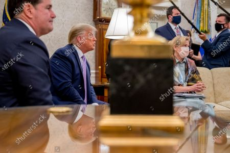 President Donald Trump, second from left, accompanied by Arizona Gov. Doug Ducey, left, and Dr. Deborah Birx, White House coronavirus response coordinator, right, speaks in the Oval Office of the White House in Washington