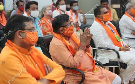 Leader of opposition Gulb Chand Katariya folds his hands in reverence while accompanied by BJP workers watching a live telecast of PM Narendra Modi performing the foundation stone laying ceremony for the Ram Temple, at BJP office  on August 5, 2020 in Jaipur, India.  The grand celebrations for the bhoomi pujan started at 8 am and Prime Minister Narendra Modi performed the Ayodhya Ram Mandir bhoomi pujan at the auspicious time of 12:40 pm.
