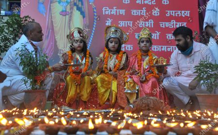 Children dressed up as mythological characters and lamps lit at a temple in Sector 45 to celebrate the foundation laying in Ayodhya of the Ram Temple on August 5, 2020 in Chandigarh, India. The grand celebrations for the bhoomi pujan started at 8 am and Prime Minister Narendra Modi performed the Ayodhya Ram Mandir bhoomi pujan at the auspicious time of 12:40 pm.