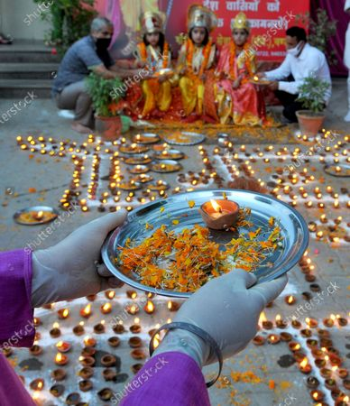 Devotees lit lamps at a temple in Sector 45 to celebrate the foundation laying in Ayodhya of the Ram Temple on August 5, 2020 in Chandigarh, India. The grand celebrations for the bhoomi pujan started at 8 am and Prime Minister Narendra Modi performed the Ayodhya Ram Mandir bhoomi pujan at the auspicious time of 12:40 pm.