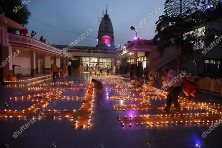 People lit five thousand one hundred earthen lamps 'Diyas' at Shri Ram Temple on the occasion of the foundation laying ceremony of Ram temple in Ayodhya, at Sector-4, near MM Public School on August 5, 2020 in Gurugram, India. The grand celebrations for the bhoomi pujan started at 8 am and Prime Minister Narendra Modi performed the Ayodhya Ram Mandir bhoomi pujan at the auspicious time of 12:40 pm.