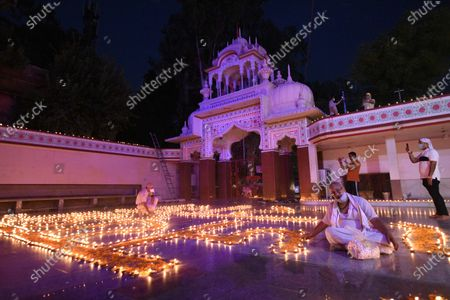 Earthen lamps lit at Shri Ram Temple on the occasion of the foundation laying ceremony of Ram temple in Ayodhya, at Sector-4, near MM Public School on August 5, 2020 in Gurugram, India. The grand celebrations for the bhoomi pujan started at 8 am and Prime Minister Narendra Modi performed the Ayodhya Ram Mandir bhoomi pujan at the auspicious time of 12:40 pm.