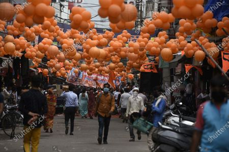 A view of the decorated Sadar Bazar with saffron-colored balloon in the wake of the 'Bhoomi Poojan' ceremony of Ram temple in Ayodhya, at Sohna Chowk on August 5, 2020 in Gurugram, India. The grand celebrations for the bhoomi pujan started at 8 am and Prime Minister Narendra Modi performed the Ayodhya Ram Mandir bhoomi pujan at the auspicious time of 12:40 pm.