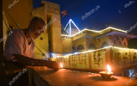 A man lights earthen lamps to celebrate the foundation laying ceremony of the Ram temple in Ayodhya, at VHP Headquarters in Sankat Mochan Ashram, RK Puram  on August 5, 2020 in New Delhi, India. The grand celebrations for the bhoomi pujan started at 8 am and Prime Minister Narendra Modi performed the Ayodhya Ram Mandir bhoomi pujan at the auspicious time of 12:40 pm.
