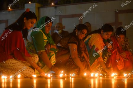 Earthen lamps being lit to celebrate the foundation laying ceremony of the Ram temple in Ayodhya, at VHP Headquarters in Sankat Mochan Ashram, RK Puram  on August 5, 2020 in New Delhi, India. The grand celebrations for the bhoomi pujan started at 8 am and Prime Minister Narendra Modi performed the Ayodhya Ram Mandir bhoomi pujan at the auspicious time of 12:40 pm.