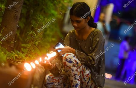 A girl lights earthen lamps to celebrate the foundation laying ceremony of the Ram temple in Ayodhya, at VHP Headquarters in Sankat Mochan Ashram, RK Puram  on August 5, 2020 in New Delhi, India. The grand celebrations for the bhoomi pujan started at 8 am and Prime Minister Narendra Modi performed the Ayodhya Ram Mandir bhoomi pujan at the auspicious time of 12:40 pm.