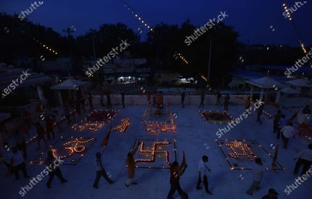 Earthen lamps lit up in various shapes as people celebrate the foundation stone laying in Ayodhya of the Ram Temple, at Jhandewala Mandir,  on August 5, 2020 in New Delhi, India. The grand celebrations for the bhoomi pujan started at 8 am and Prime Minister Narendra Modi performed the Ayodhya Ram Mandir bhoomi pujan at the auspicious time of 12:40 pm.