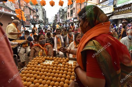 Sweets being distributed while people watch the live telecast of the Ram Temple foundation stone laying ceremony happening in Ayodhya, at Mulatani Dhanda at Paharganj on August 5, 2020 in New Delhi, India. The grand celebrations for the bhoomi pujan started at 8 am and Prime Minister Narendra Modi performed the Ayodhya Ram Mandir bhoomi pujan at the auspicious time of 12:40 pm.