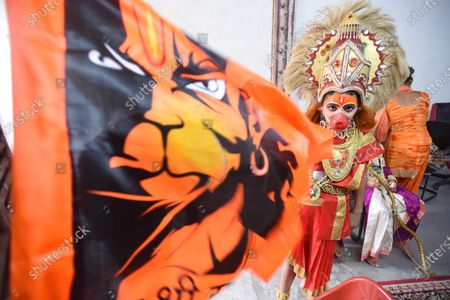 A child in a Hanuman costume during a procession in Pandav Nagar in celebration of the foundation stone laying in Ayodhya of the Ram Temple,  on August 5, 2020 in New Delhi, India. The grand celebrations for the bhoomi pujan started at 8 am and Prime Minister Narendra Modi performed the Ayodhya Ram Mandir bhoomi pujan at the auspicious time of 12:40 pm.