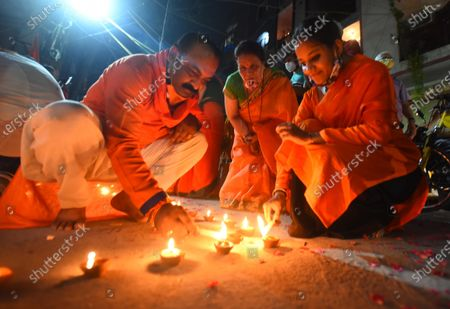 People light lamps in Pandav Nagar to celebrate the Bhoomi Poojan in Ayodhya of the Ram Temple,  on August 5, 2020 in New Delhi, India. The grand celebrations for the bhoomi pujan started at 8 am and Prime Minister Narendra Modi performed the Ayodhya Ram Mandir bhoomi pujan at the auspicious time of 12:40 pm.