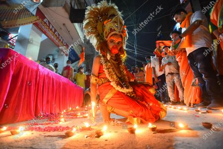 A person dressed as the Hindu god Hanuman lights lamps in Pandav Nagar to celebrate the Bhoomi Poojan in Ayodhya of the Ram Temple,  on August 5, 2020 in New Delhi, India. The grand celebrations for the bhoomi pujan started at 8 am and Prime Minister Narendra Modi performed the Ayodhya Ram Mandir bhoomi pujan at the auspicious time of 12:40 pm.