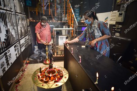 Praveen Khandelwal (L), President CAIT lights a lamp to commemorate Bhoomi Pujan of Ram Temple in Ayodhya, at Karol Bagh on August 5, 2020 in New Delhi, India. The grand celebrations for the bhoomi pujan started at 8 am and Prime Minister Narendra Modi performed the Ayodhya Ram Mandir bhoomi pujan at the auspicious time of 12:40 pm.