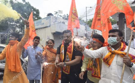 Delhi BJP supporters celebrate on the occasion of the foundation stone laying ceremony for the construction of Ram Temple in Ayodhya, at Defence Enclave on August 5, 2020 in New Delhi, India. The grand celebrations for the bhoomi pujan started at 8 am and Prime Minister Narendra Modi performed the Ayodhya Ram Mandir bhoomi pujan at the auspicious time of 12:40 pm.