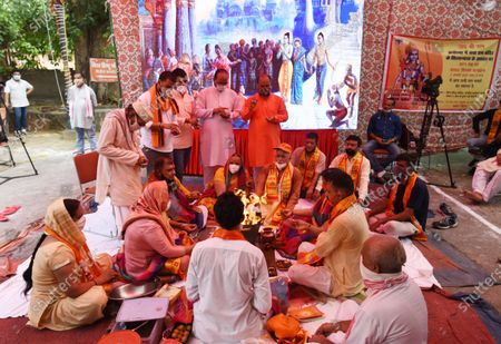 Devotees perform Bhoomi Pujan rituals of the construction of the Ram Mandir in Ayodhya, at VHP Office at RK Puram on August 5, 2020 in New Delhi, India. The grand celebrations for the bhoomi pujan started at 8 am and Prime Minister Narendra Modi performed the Ayodhya Ram Mandir bhoomi pujan at the auspicious time of 12:40 pm.