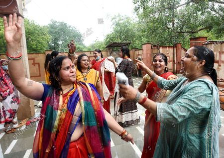 Devotees sing bhajans while performing Bhoomi Pujan rituals of the construction of the Ram Mandir in Ayodhya, at VHP Office at RK Puram on August 5, 2020 in New Delhi, India. The grand celebrations for the bhoomi pujan started at 8 am and Prime Minister Narendra Modi performed the Ayodhya Ram Mandir bhoomi pujan at the auspicious time of 12:40 pm.