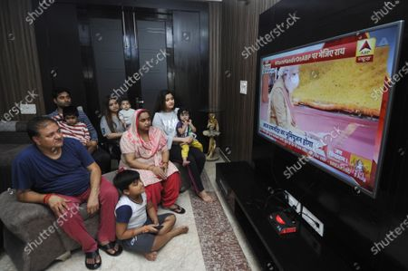 Residents in Sector 27 watch a live telecast of the foundation stone laying ceremony of the Ram Temple in Ayodhya on August 5, 2020 in Noida, India.  The grand celebrations for the bhoomi pujan started at 8 am and Prime Minister Narendra Modi performed the Ayodhya Ram Mandir bhoomi pujan at the auspicious time of 12:40 pm.