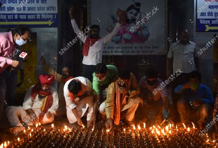 People light earthen lamps at a Hanuman temple to celebrate the Bhumi Pujan ceremony of Ayodhya's Ram Temple on August 5, 2020 in Patna, India. The grand celebrations for the bhoomi pujan started at 8 am and Prime Minister Narendra Modi performed the Ayodhya Ram Mandir bhoomi pujan at the auspicious time of 12:40 pm.