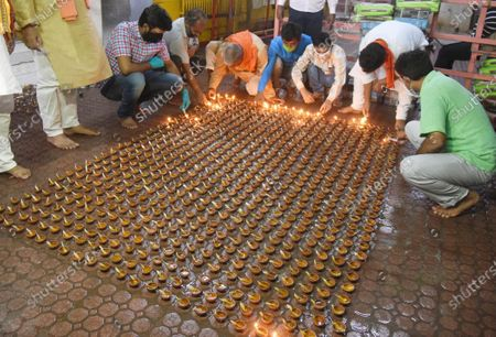 Devotees lighting earthen lamps at Mahavir Temple in celebration of the foundation laying in Ayodhya of the Ram Temple on August 5, 2020 in Patna, India. The grand celebrations for the bhoomi pujan started at 8 am and Prime Minister Narendra Modi performed the Ayodhya Ram Mandir bhoomi pujan at the auspicious time of 12:40 pm.