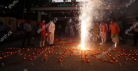 BJP workers bursting crackers to celebrate the Bhoomi Pujan of Ayodhya's Ram Temple on August 5, 2020 in  Lucknow, India. The grand celebrations for the bhoomi pujan started at 8 am and Prime Minister Narendra Modi performed the Ayodhya Ram Mandir bhoomi pujan at the auspicious time of 12:40 pm.